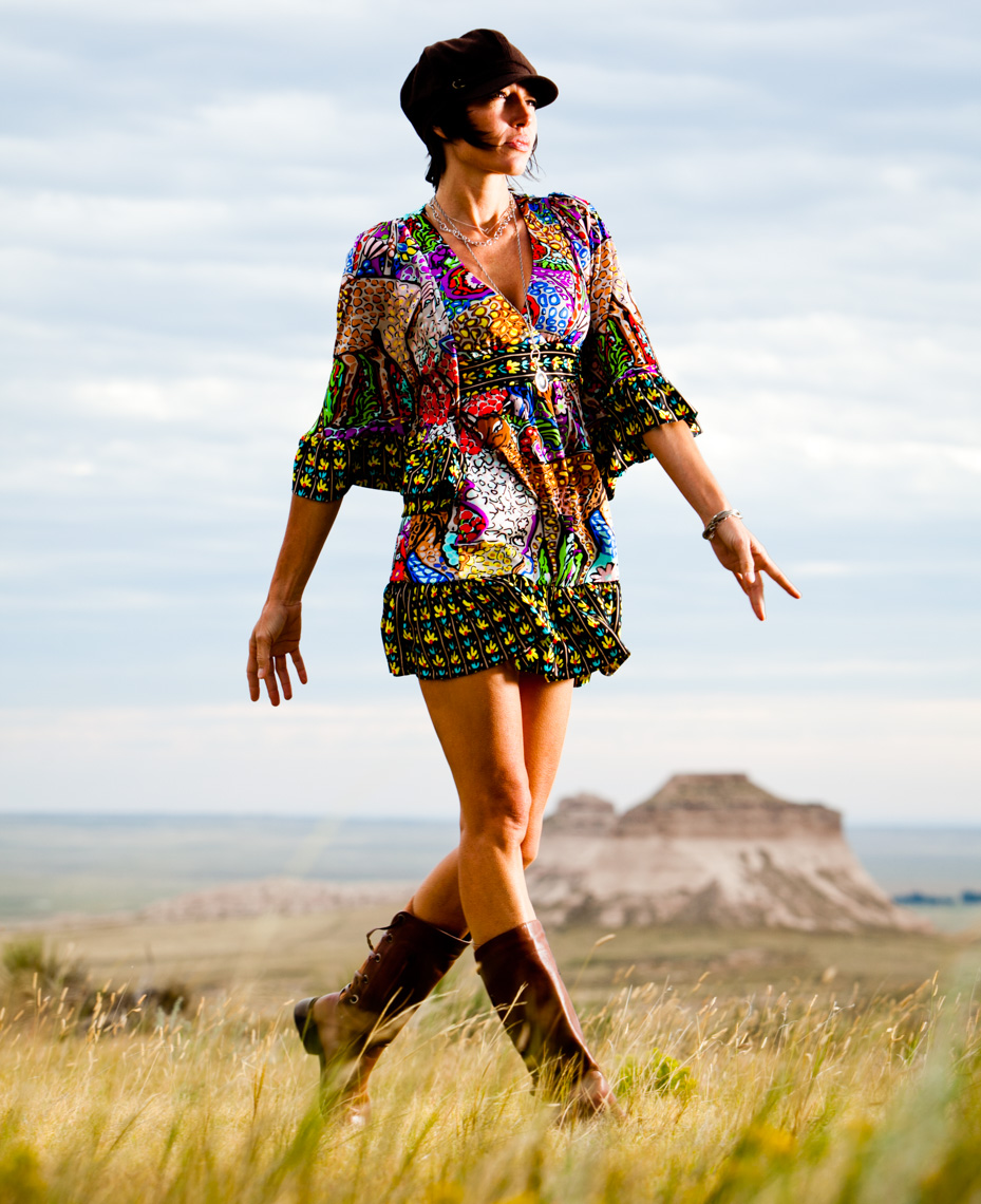 A portrait and of an attractive, beautiful, glamourous, sexy, fun, woman, showcasing her beauty, femininity as she explores the land around the Pawnee Grasslands. She wears a flowing short dress. This portrait was created by Steve Glass, owner of Glass Photography Portrait Studio. Steve offers a beauty portrait service (a makeover portrait) session, where professional hair, professional makeup, professional styling, are provided in the sitting fee. In all of his portraits they are looking to uncover the unique interests, creativity and beauty that each person possesses. This deepest portion of a person that is created in the image of God, the Imago Dei. Steve Glass, a professional portrait photographer of Glass Photography services the men, women, children, kids, families, business and people of Fort Collins, Windsor, Loveland, Wellington and the surrounding areas of Northern Colorado and southern Wyoming (and sometime Denver), through professional photography by creating timeless portraits and heirloom prints, ranging from corporate portraits, corporate headshots, environmental portraits, editorial portraits, and beauty portraits.