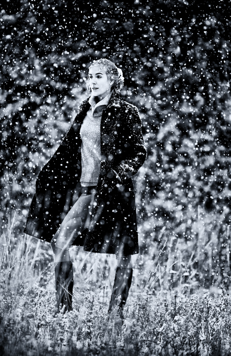 A beauty portrait and of an attractive, beautiful, glamourous, sexy, fun, woman, showcasing her beauty, femininity, and as she walks through a meadow in a snowstorm! She wears riding boots and long wool jacket. This portrait was created by Steve Glass, owner of Glass Photography Portrait Studio. Steve offers a beauty portrait service (a makeover portrait) session, where professional hair, professional makeup, professional styling, are provided in the sitting fee. In all of his portraits they are looking to uncover the unique interests, creativity and beauty that each person possesses. This deepest portion of a person that is created in the image of God, the Imago Dei. Steve Glass, a professional portrait photographer of Glass Photography services the men, women, children, kids, families, business and people of Fort Collins, Windsor, Loveland, Wellington and the surrounding areas of Northern Colorado and southern Wyoming (and sometime Denver), through professional photography by creating timeless portraits and heirloom prints, ranging from corporate portraits, corporate headshots, environmental portraits, editorial portraits, and beauty portraits.