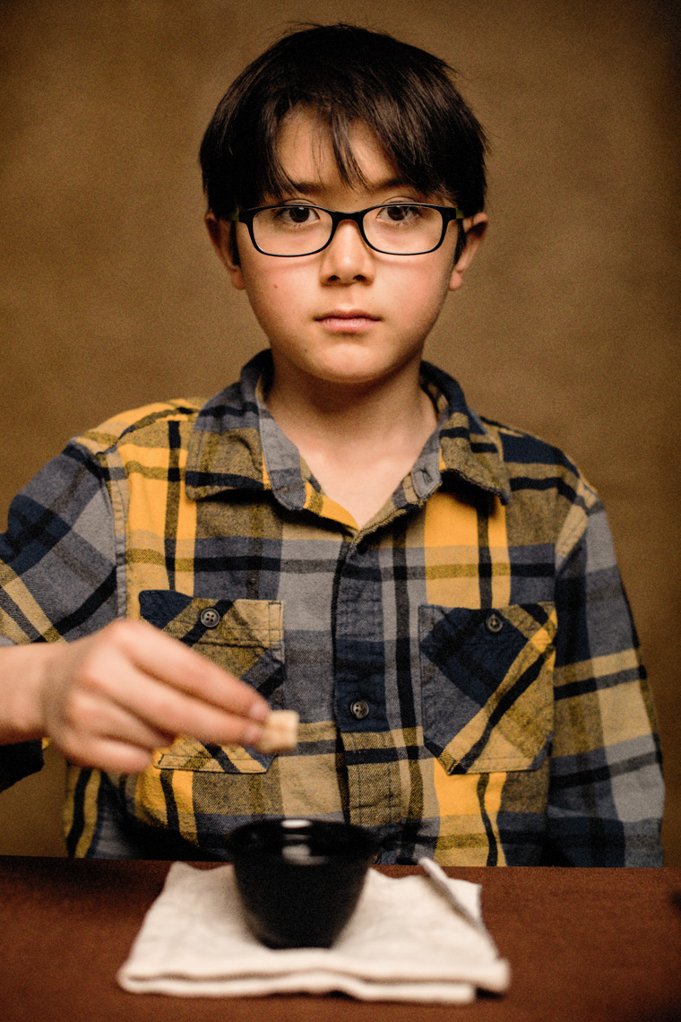 A studio portrait of a strong, handsome 9-year-old boy who loves cups of tea, tall tales, stories and a good conversation. He wants to be a comic or a writer someday – or both. This portrait was created by Steve Glass, owner of Glass Photography Portrait Studio. In all, of his portraits he is seeking the Imago Dei – the image of God – in each of his subjects. This means uncovering the unique interests, creativity, ingenuity and beauty that each person possesses. This deepest portion of a person that is created in the image of God, the Imago Dei. Steve Glass, a professional portrait photographer of Glass Photography services the men, women, children, kids, families, business and people of Fort Collins, Windsor, Loveland, Wellington and the surrounding areas of Northern Colorado and southern Wyoming (and sometime Denver), through professional photography by creating timeless portraits and heirloom prints, ranging from corporate portraits, corporate headshots, environmental portraits, editorial portraits, and beauty portraits.