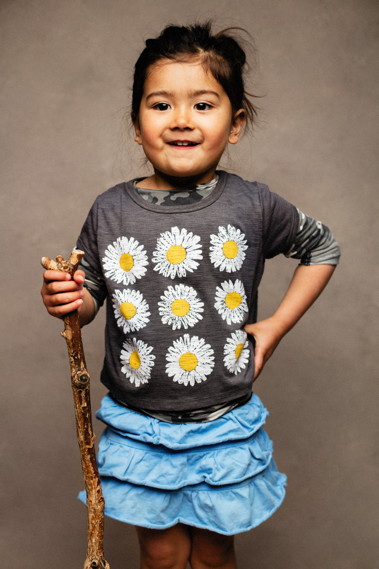 A studio portrait of an adorable, cute 3-year-old girl who loves hiking with her Mom, Dad and brother. She likes to use her hiking stick when going on walks. This portrait was created by Steve Glass, owner of Glass Photography Portrait Studio. In all of his portraits he is seeking the Imago Dei – the image of God – in each of his subjects. This means uncovering the unique interests, creativity, ingenuity and beauty that each person possesses. This deepest portion of a person that is created in the image of God, the Imago Dei. Steve Glass, a professional portrait photographer of Glass Photography services the men, women, children, kids, families, business and people of Fort Collins, Windsor, Loveland, Wellington and the surrounding areas of Northern Colorado and southern Wyoming (and sometime Denver), through professional photography by creating timeless portraits and heirloom prints, ranging from corporate portraits, corporate headshots, environmental portraits, editorial portraits, and beauty portraits.