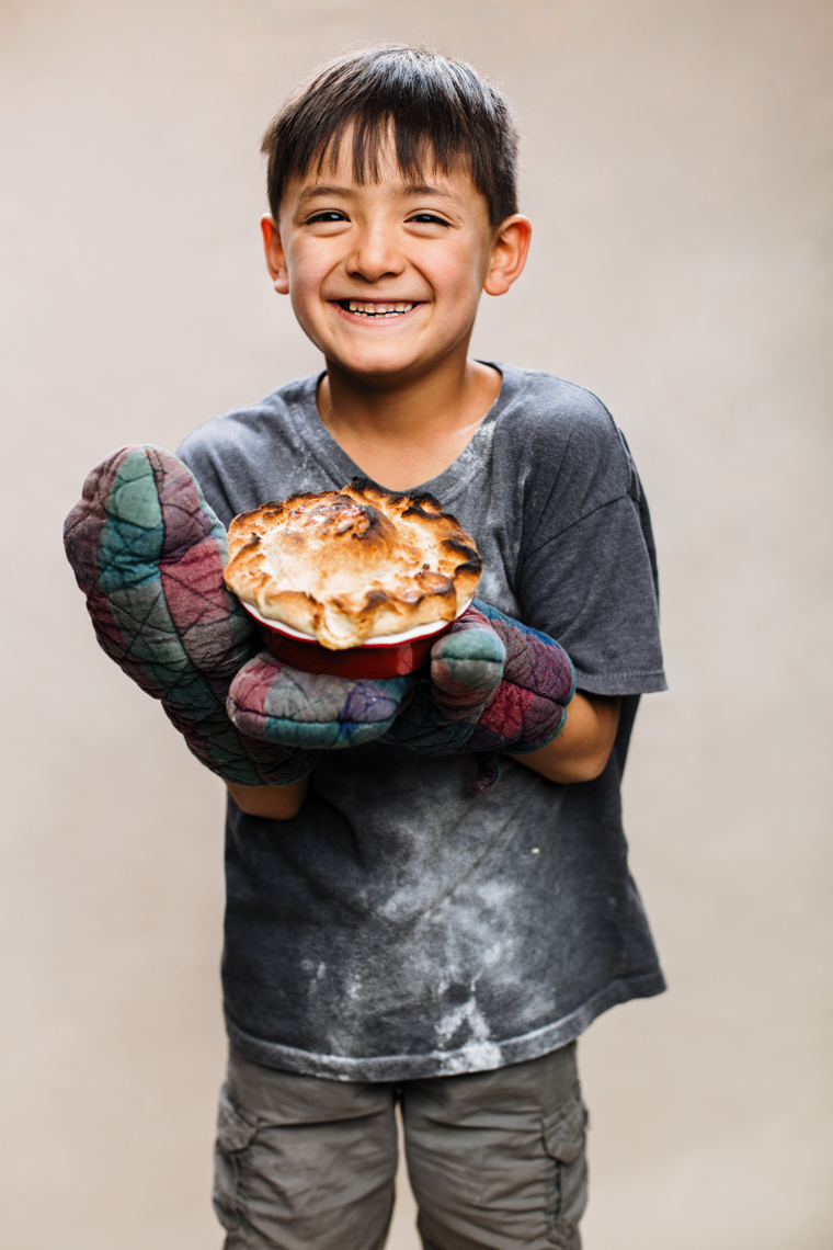 A studio portrait of a strong, handsome 7-year-old boy who loves making pies. This portrait was created by Steve Glass, owner of Glass Photography Portrait Studio. In all of his portraits he is seeking the Imago Dei – the image of God – in each of his subjects. This means uncovering the unique interests, creativity, ingenuity and beauty that each person possesses. This deepest portion of a person that is created in the image of God, the Imago Dei. Steve Glass, a professional portrait photographer of Glass Photography services the men, women, children, kids, families, business and people of Fort Collins, Windsor, Loveland, Wellington and the surrounding areas of Northern Colorado and southern Wyoming (and sometime Denver), through professional photography by creating timeless portraits and heirloom prints, ranging from corporate portraits, corporate headshots, environmental portraits, editorial portraits, and beauty portraits.